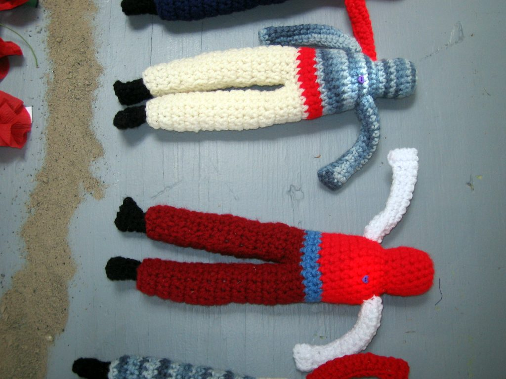 Close up of crocheted soldiers.